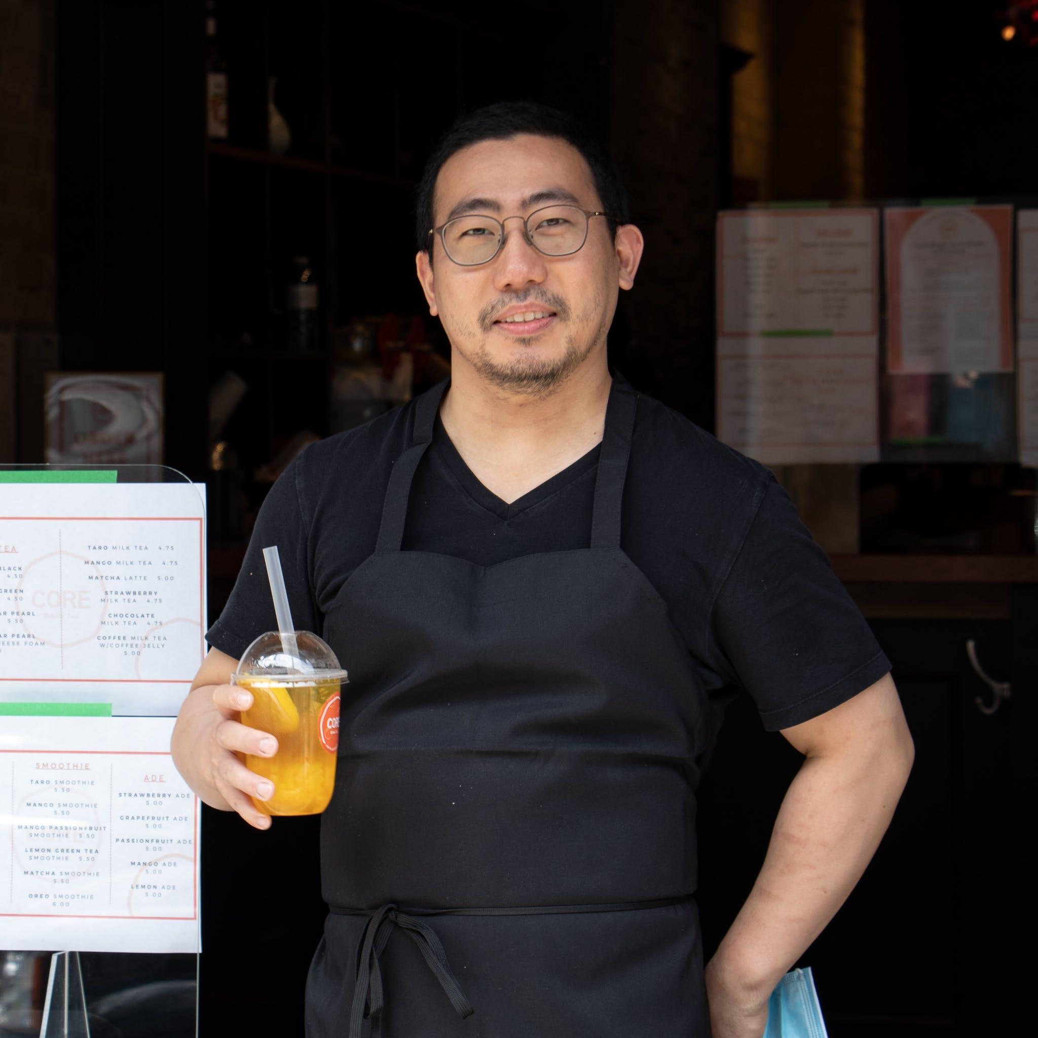 Chef Hyun Jung Kim outside his restaurant holding Core Bubble Tea