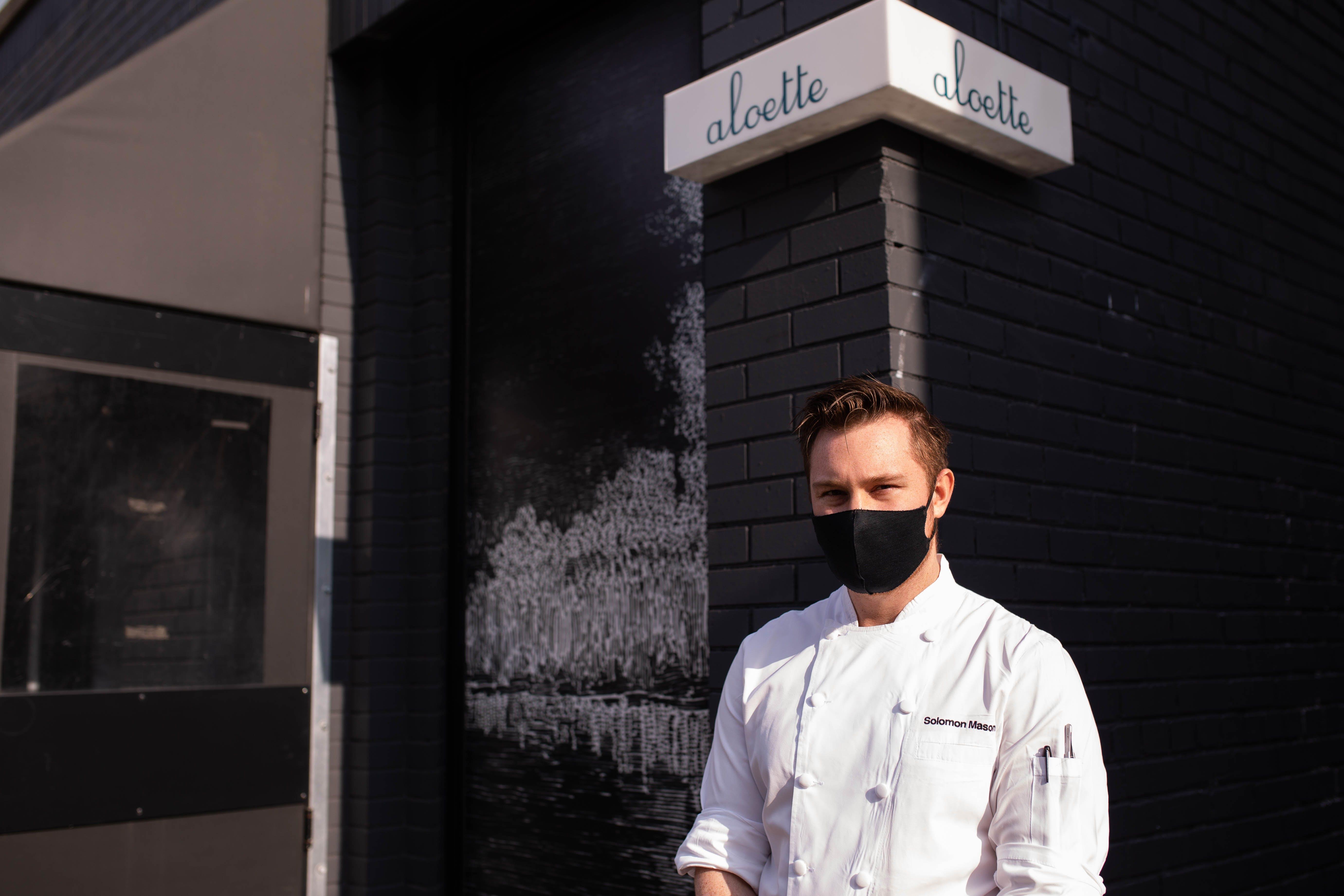 Solomon Mason stands out front of Toronto restaurant Aloette.
