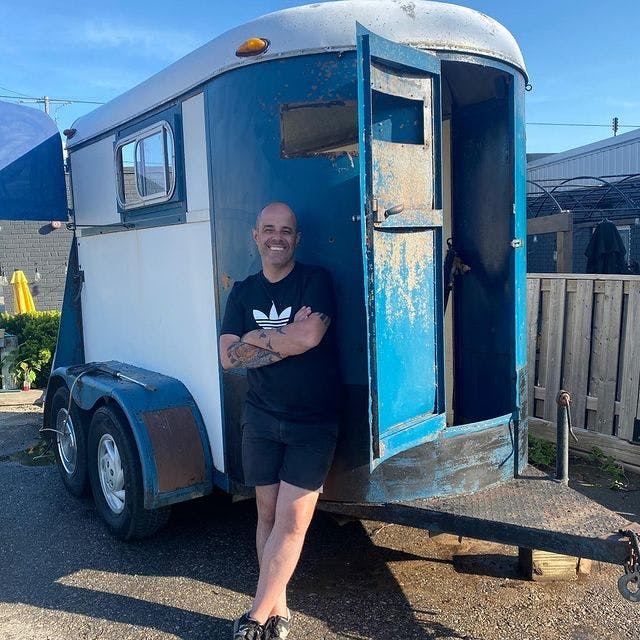 Carlos Oliveira with the pre-renovated horse trailer