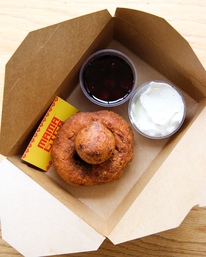 Papanasi (ricotta donuts) with sour cream and cherry compote
