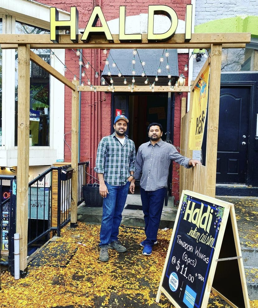 Haldi owners Harish and Devesh outside their restaurant
