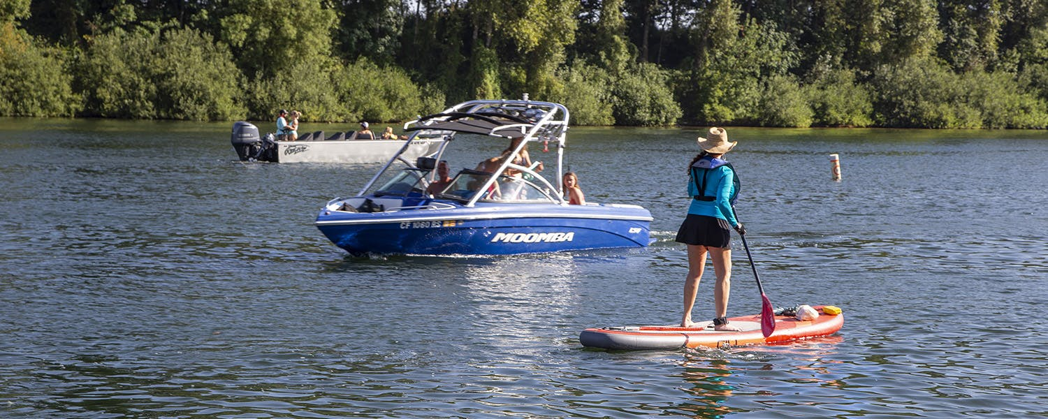 Desireé Neel from La Muse Beauty, paddleboarding on the Willamette River at Rogers Landing