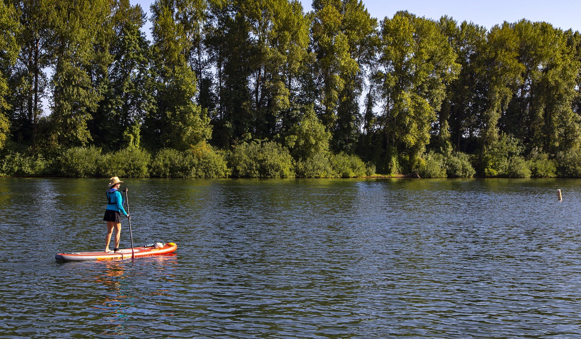 Desireé Neel on a paddleboard on the Willamette River at Rogers Landing