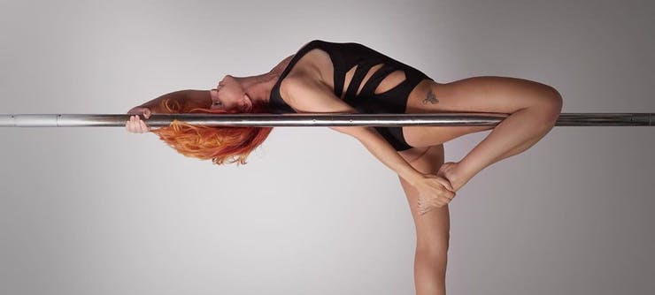 Bexiita, owner of Revved Up Pole teaching a pole class