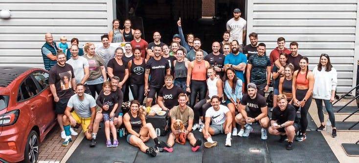 Members of CrossFit 13 assemble for a group photo