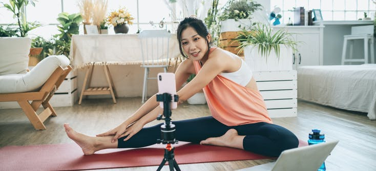 girl giving an online fitness class at home