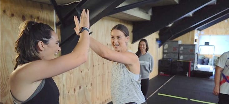 lizzie fisher owner of crossfit 2012 and a client