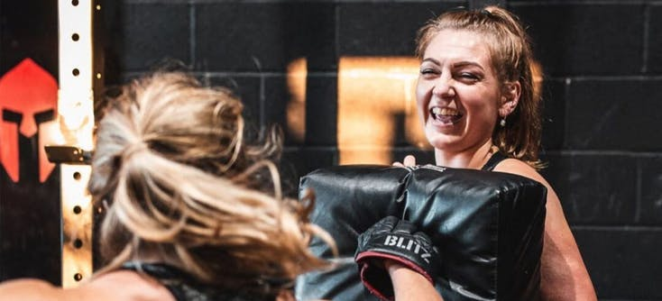 two spartan chamber customers females boxing