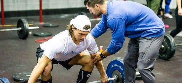 colchester fitness centre crossfit coach teaching a client
