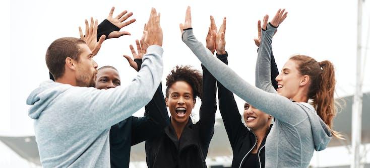 group of athletes celebrating