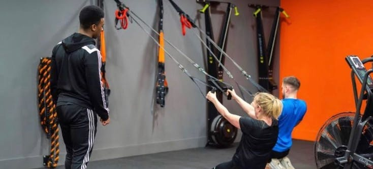 the fitness box instructor teaching a client