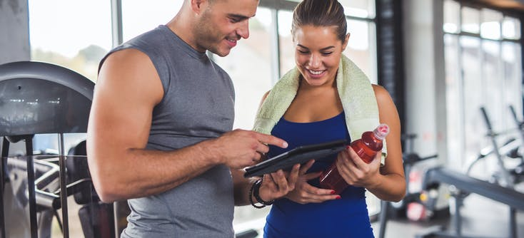 personal trainer collecting customer information from a new client