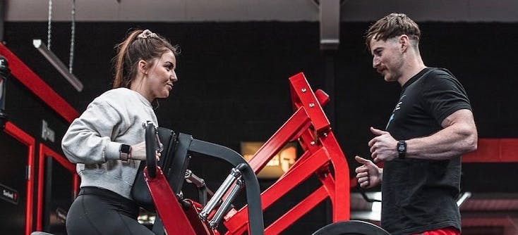 a trainer and client at the spartan chamber gym
