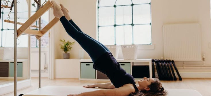 pilates instructor giving a class at her studio
