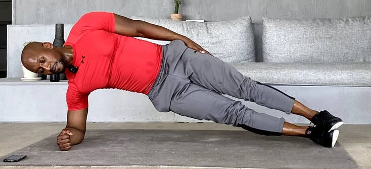 Personal trainer, Jason Altidor, doing a side plank