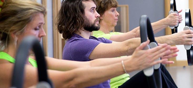 image of karen grinter's son daniel teaching a Pilates class