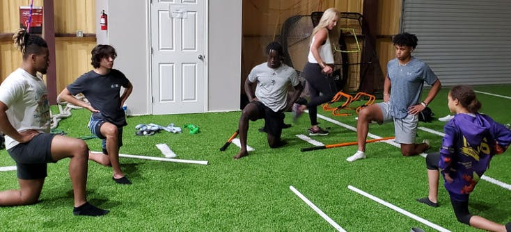 athletes stretching during a small group personal training session