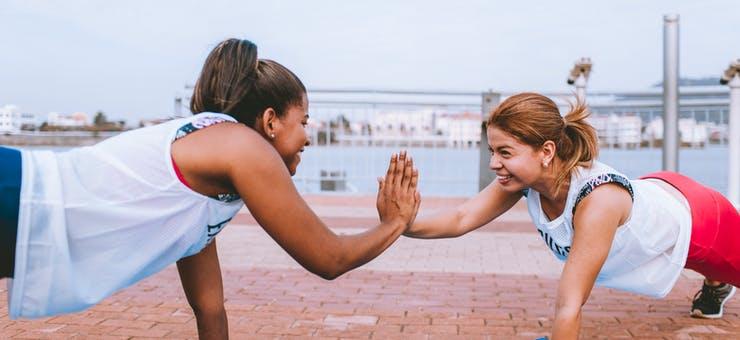 two girls exchanging a high-five