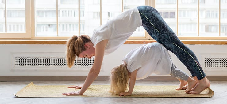 a mom and her child working out