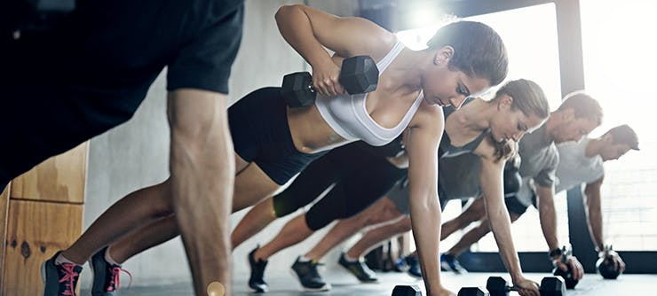 group workout class with dumbbells