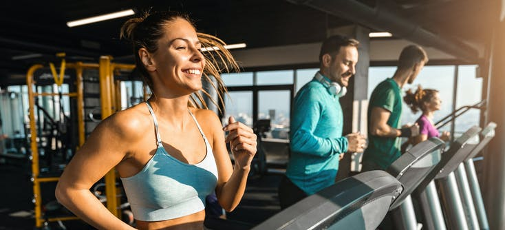 image of people at the gym running on the treadmill