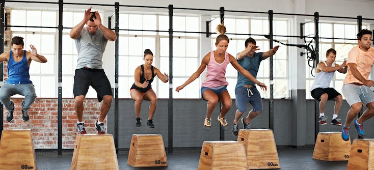 fitness class jumping on boxes
