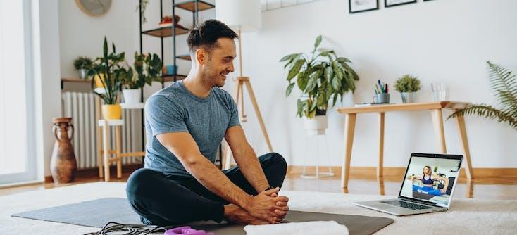 man taking an online fitness class