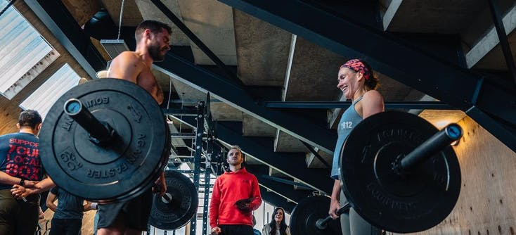 two people taking a CrossFit class with TeamUp