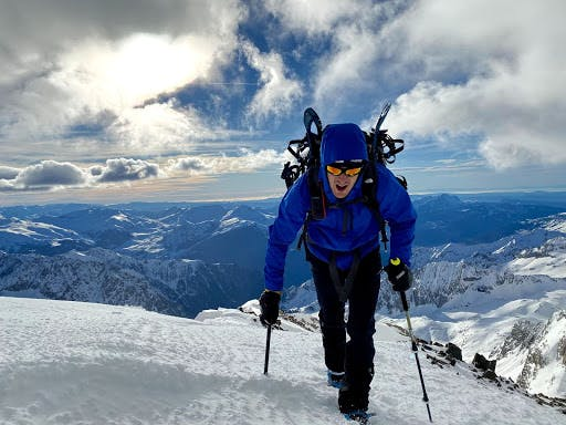 A man climbing a snow-covered mountain in the Pyrenees