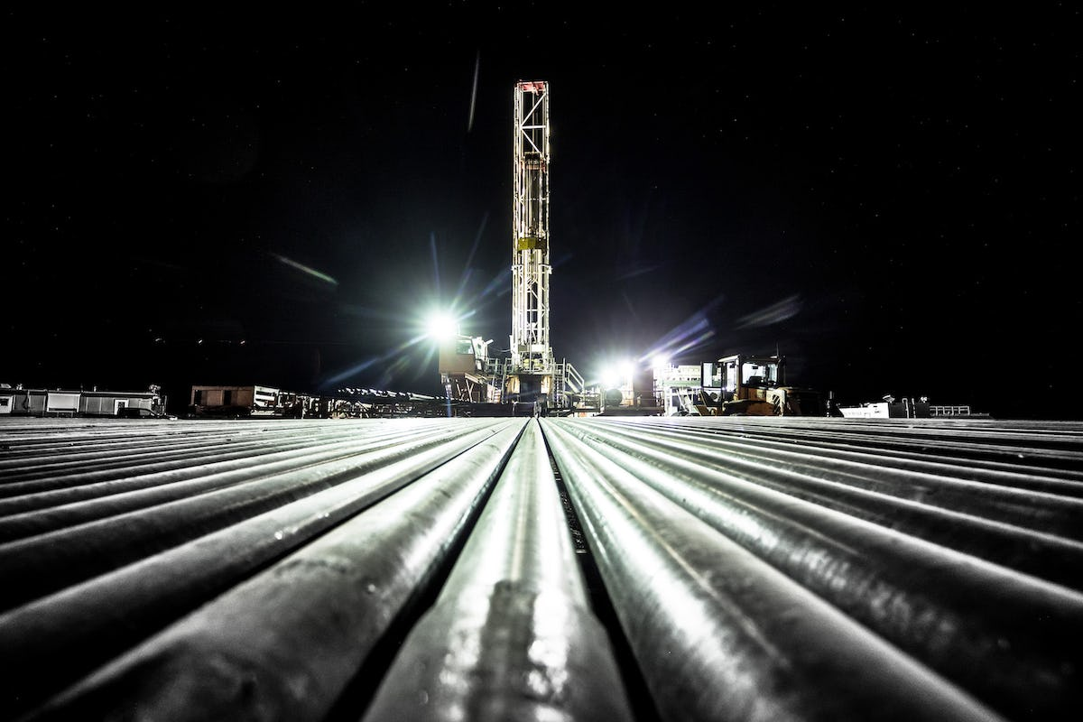 Oil rig machinery at night.