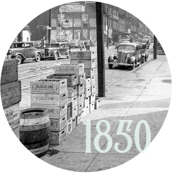 strip district sidewalks with wooden boxes and barrels, and the text '1850'