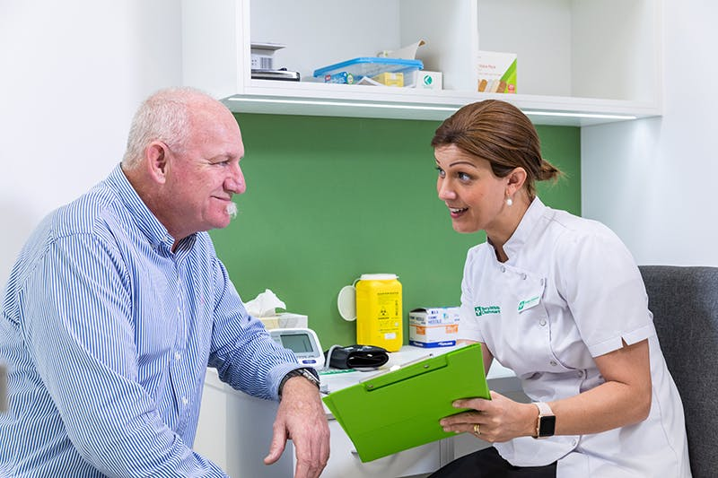 Pharmacists giving advice on Flu Vaccination services