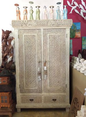 Closet with detailed wood carvings