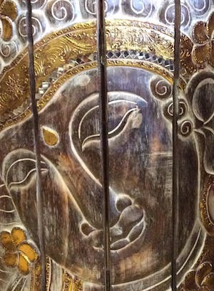 Wooden panel with Buddha face