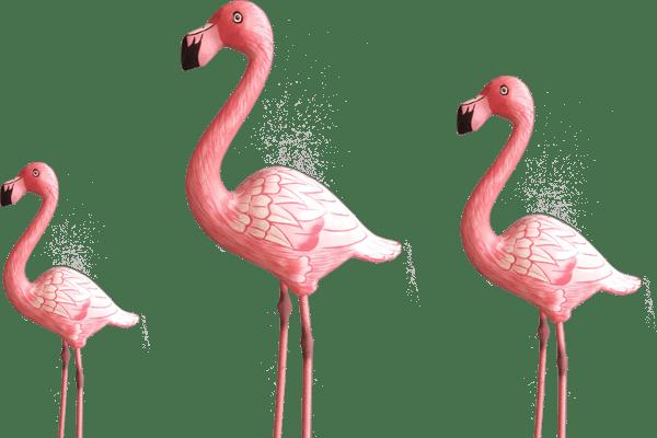 Three handcarved wooden flamingo's