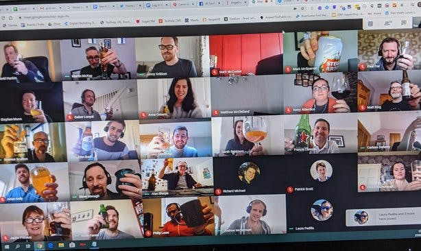 Google Meet grid view showing over 60 Texthelp employees on a virtual call