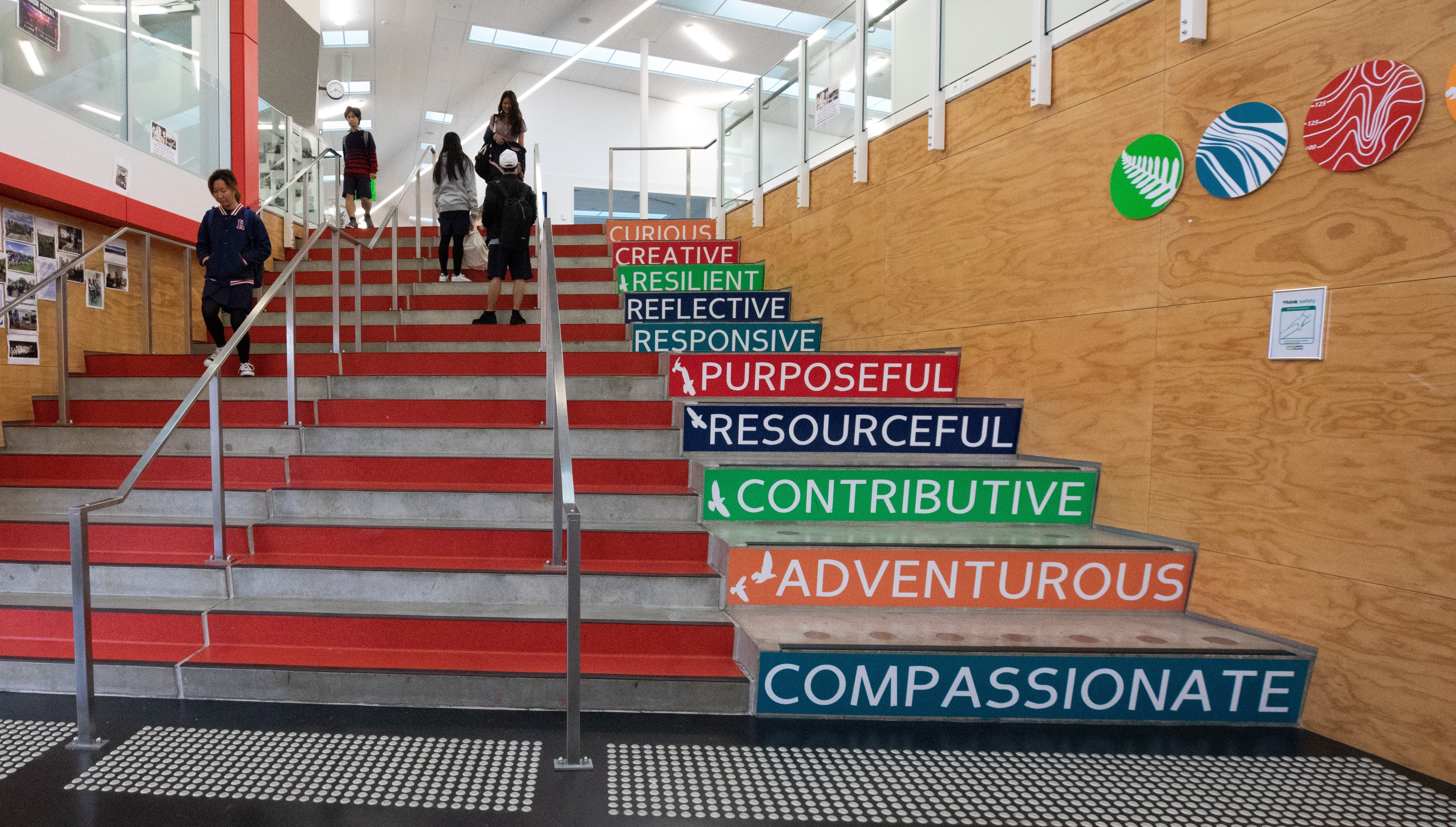Stairs within Hobsonville Point Secondary School that display their key values