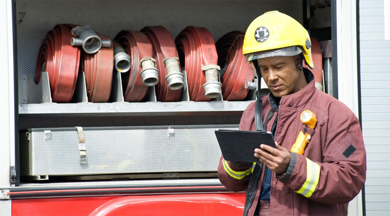 Firefighter using tablet