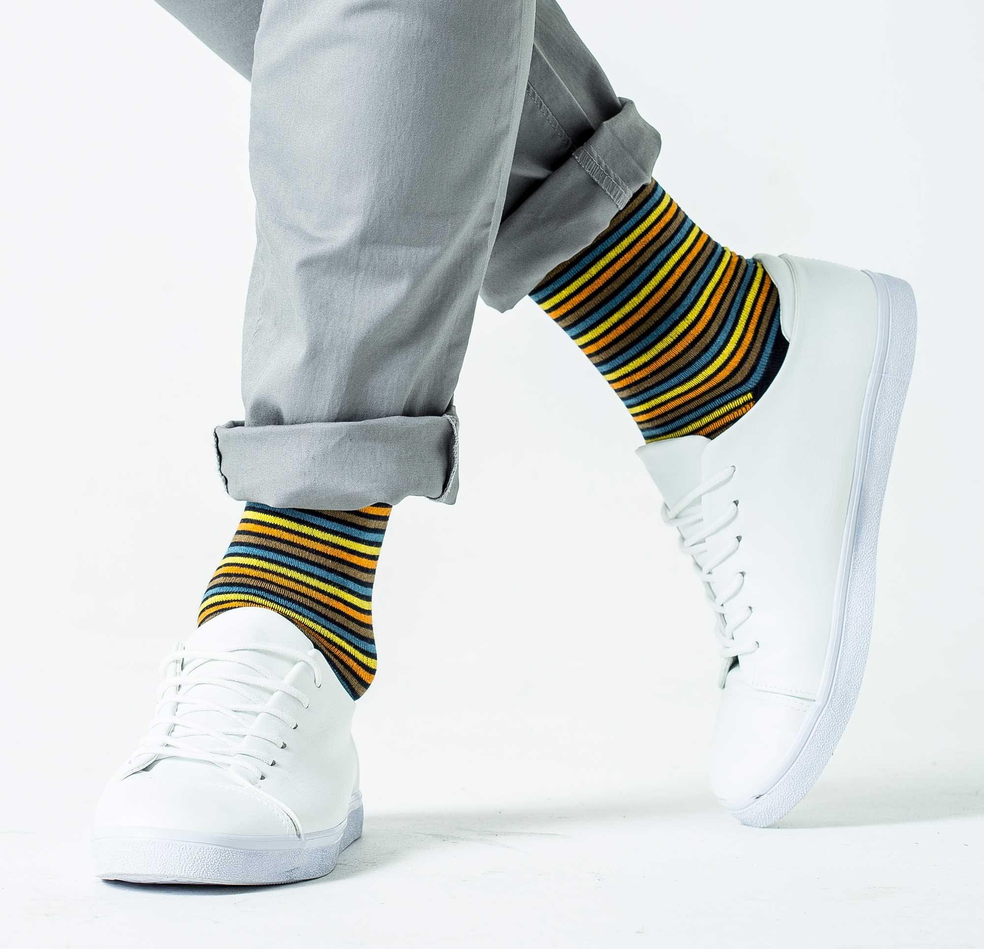 fashionable mens socks at a party