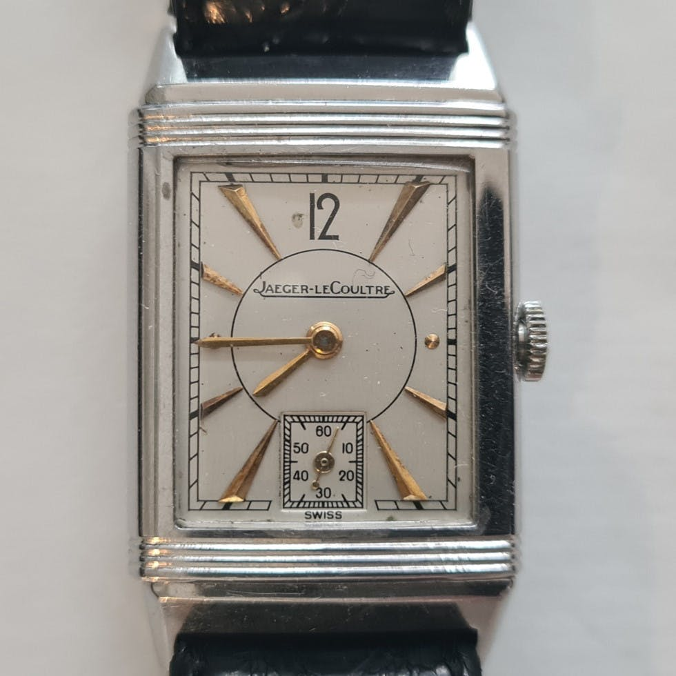 Men's Art Deco Style Reverso watch with gold hands and indices from 1946