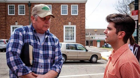 Kenyon student George Costanzo and Pastor Bill Dunfee of New Beginnings Church talk in the Mount Vernon town square.