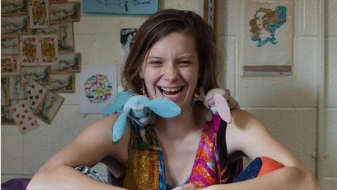 Teahelahn Keithrafferty, class of 2019, perches her two stuffed bunnies on her shoulders