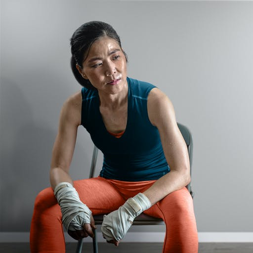 A portrait of a person sitting on a chair after a workout