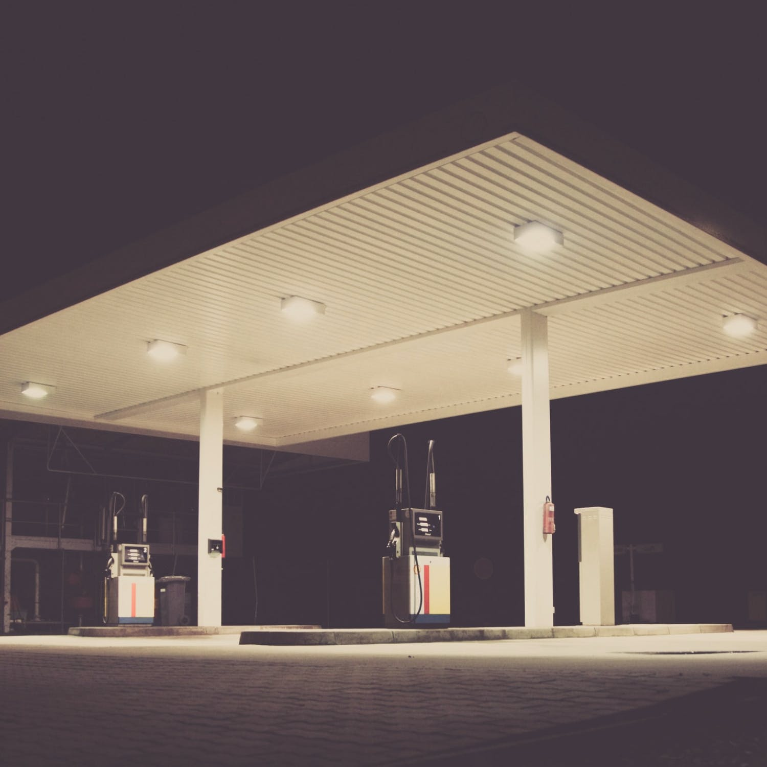 An empty gas station at night