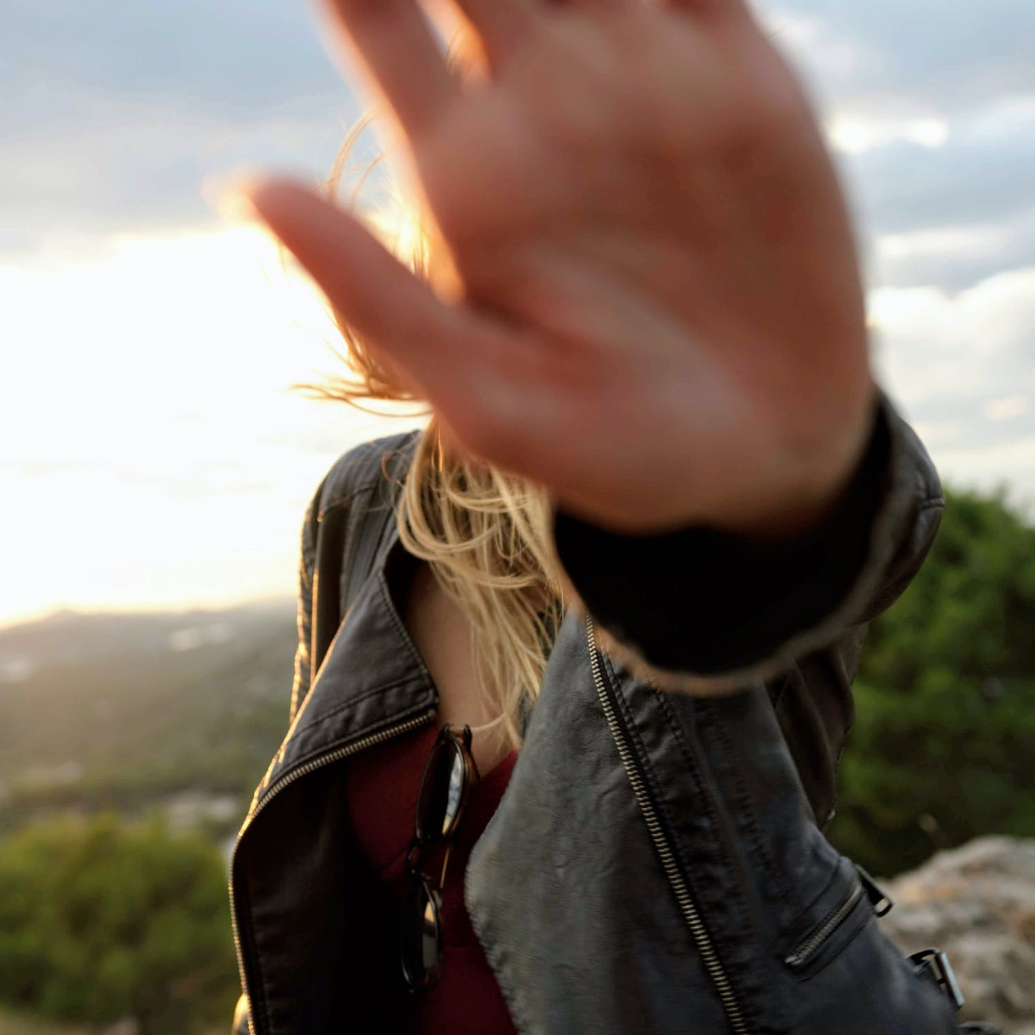 Woman holding palm in front of camera