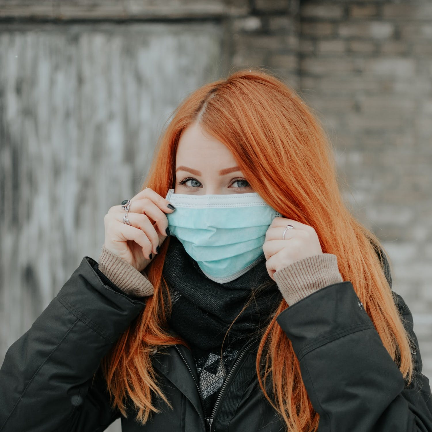 A woman wears a protective mask