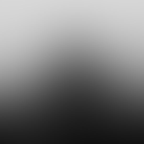 Silhouette of man on train tracks