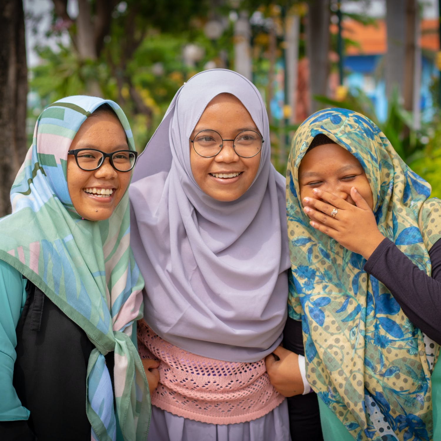 Three Muslim women laughing