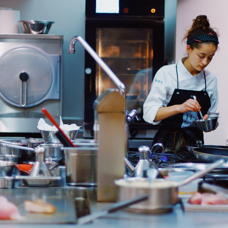 Female chef in professional kitchen