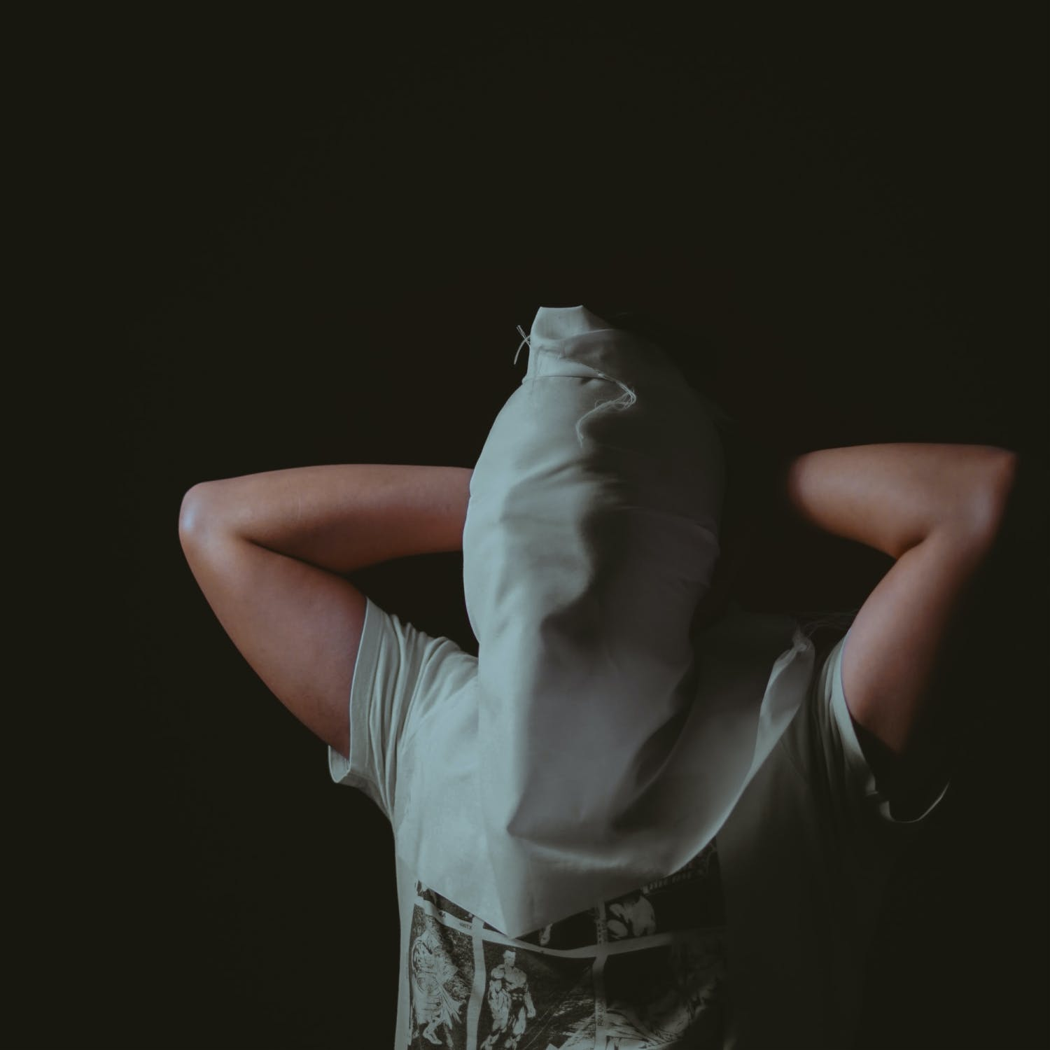 Man with waterboarding cloth over face